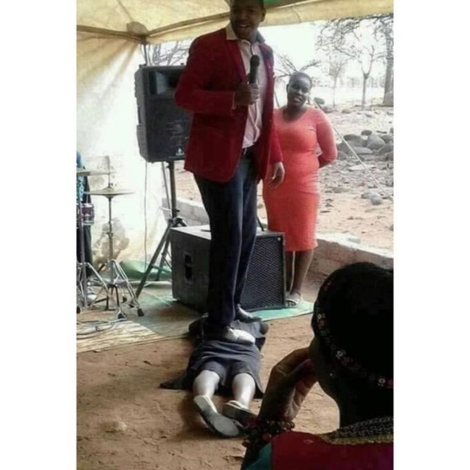 Meet Pastor Who Performs Miracle By Stepping On Member's Buttocks