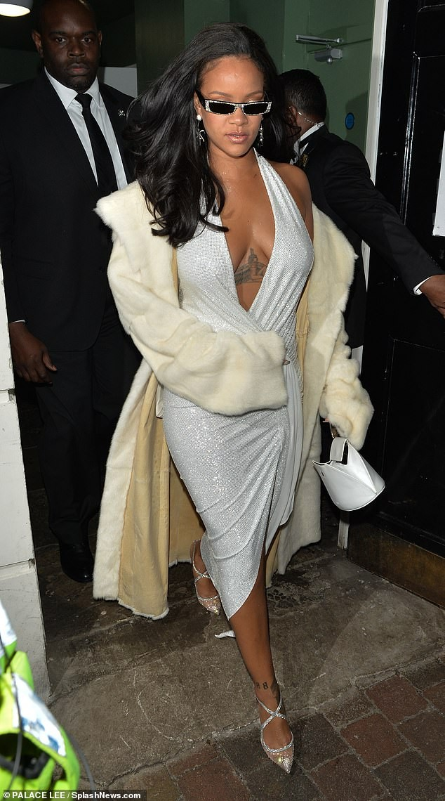 Rihanna Goes Braless In Silver Dress For New Year's Eve Celebrations